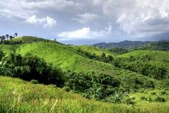 Green mountain on cloud Stock Photos