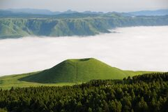 Green Mountain in Front of White Clouds Royalty Free Stock Photo