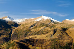 Green mountain with the glacier. Autumn in the mountains of the North Caucasus. Green mountain with the glacier royalty free stock photos
