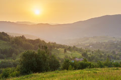 Green mountain hills at golden sunset light royalty free stock image