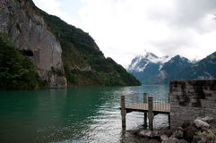 Green mountain lake and jetty in Switzerland, canton Uri Stock Images