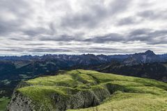 Green mountain landscape. In cloudy weather in alps Stock Photos