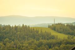 Green mountain meadow with mountain range. In the background royalty free stock photography