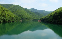 Green mountain reflection in the lake Royalty Free Stock Photo