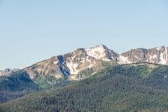 Green mountain ridge scene with blue sky summer landscape background. Green mountain ridge scene with blue sky summer landscape background royalty free stock photos