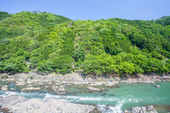 Green mountain and river in summer season Royalty Free Stock Photo