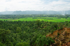 Green mountain and sandstone cliffs Stock Photo