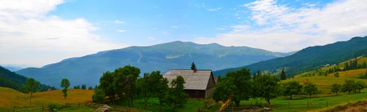 House and beautiful Carpathian landscape. stock photography