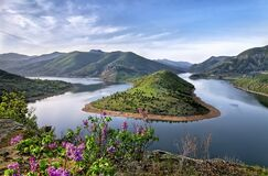 Green Mountain Surrounded by Body of Water Photo Stock Photography