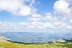 Green mountain valley landscape on a sunny summer day. Royalty Free Stock Images