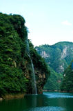 Green Mountain Waterfall. China's Guizhou Green Mountain White Cloud blue syk Waterfall Stock Photos