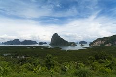 Phang Nga Bay - view from the observation deck. 4. Green mountainous islands swim in the azure sea. View from the top of the island stock photo