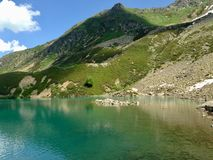 Green mountains, blue lake, scenic view, ecotourism. Travel destination - Caucasus, Russia. Travel destination - Caucasus, Russia royalty free stock images