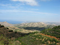 Green mountains, blue skies. A mountainscape in Cyprus. At the left we can see the Morphou bay stock image