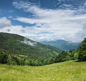 Green mountains and blue sky with clouds Royalty Free Stock Photo