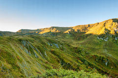 The green mountains of the Caucasian nature reserve at dawn. Beautiful green mountains against a blue sky. Dawn in the mountains. Part of the mountain Stock Photography