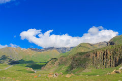 Green mountains with glaciers under clouds Royalty Free Stock Photos