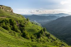 Green mountains and hills with a blue sky on a summer evening Royalty Free Stock Photo