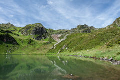 Green mountains and lake, Austria Stock Images