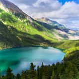 Green mountains with lake Stock Images