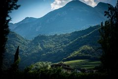 Green Mountains over Brown Wooden House stock photo