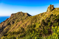 Green mountains or rock and blue sky Stock Photography