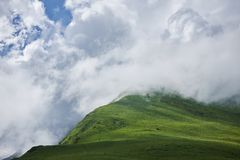 Green mountains shrouded in clouds stock images