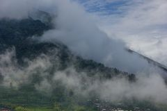 Green mountains, terraces and clouds fog royalty free stock photo