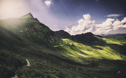 Green and Mountains Under Blue Sky and White Clouds during Daytime Royalty Free Stock Images