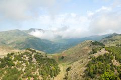 Green mountains and white clouds on the island of Crete Royalty Free Stock Images