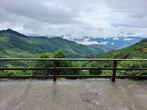Green mountains and white clouds view from balcony Stock Images