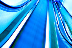 Green moving escalator Stock Images