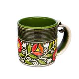 Green mug with ethnic floral ornaments on white background. Green mug with ethnic floral ornaments on the white background Royalty Free Stock Photo