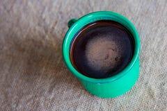 Green mug of hot chocolate Stock Photos