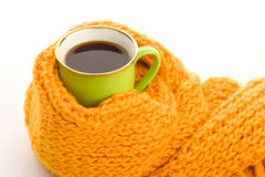 Green mug wrapped yellow scarf Royalty Free Stock Photos