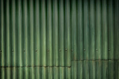Green multi-tone grunge corrugated wall with character Stock Photo