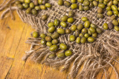 Green mung beans. Some green mung beans on a piece of sack Stock Image