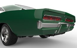 Green muscle car - focus on the tail section of the car Stock Images