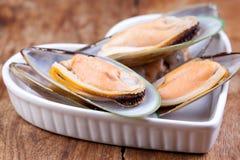 Green mussels in heart shape plate Stock Photo