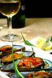 Green Mussels and White Wine. Delicious green mussels and white wine stock photo