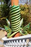 Green naga serpent on column Royalty Free Stock Image