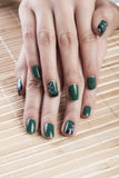 Green nail polish Royalty Free Stock Photos