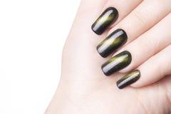 Green nail polish. Stock Photos