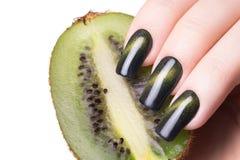 Green nail polish. Royalty Free Stock Photos