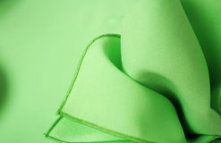 Green napkin abstract. Abstract background of a green cloth napkin Stock Photography