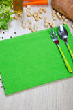 Green napkin with flatware Royalty Free Stock Images