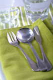 Green napkin and spoon and fork Royalty Free Stock Images