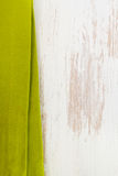 Green napkin on white wooden Stock Photo