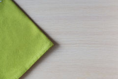 Green napkin on a wooden table Royalty Free Stock Photo
