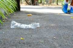 A plastic bottle of drinking water littering on the pathway ground at the park stock photos
